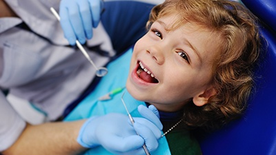 Laughing little boy in dental chair