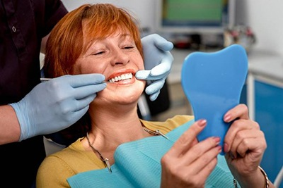 Older woman smiling at her dental appointment