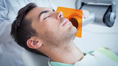 Relaxing patient receiving dental care