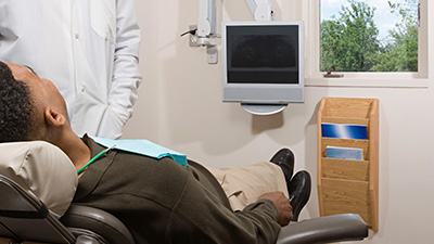Relaxed man receiving dental treatment