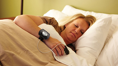 Woman completing at-home sleep test