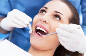 happy woman recieve crown & bridge treatment from the general dentist Irving, TX trusts