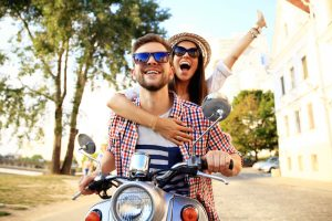 couple riding on a motorbike