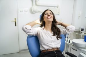 Woman smiling after getting treatment for gum disease